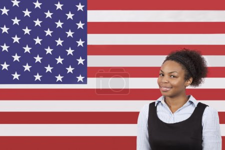 Businesswoman smiling over American flag