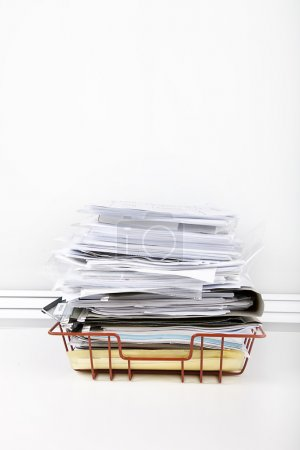Documents overflowing in desk tray