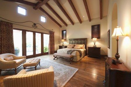 Spacious high beamed bedroom