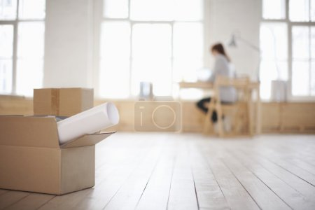 Woman sits at desk