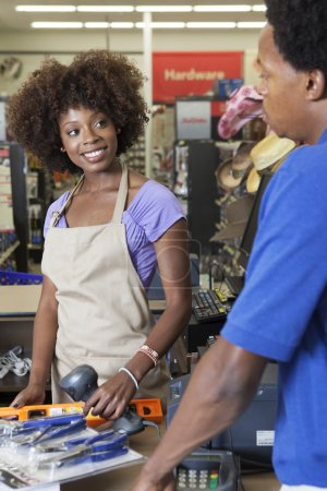 Female store clerk with customer