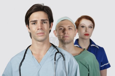 Photo for Portrait of three medical practitioners against gray background - Royalty Free Image