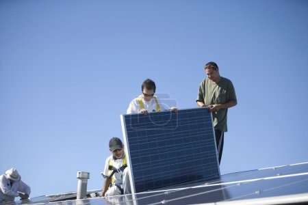 Men working on solar panelling