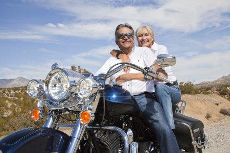 Senior couple on motorcycle