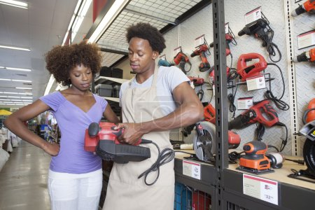 African American woman buying tool