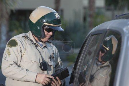 Patrol officer at window of car