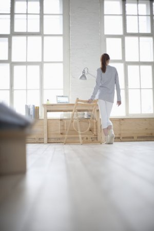 Woman walks across apartment