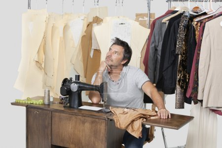 Mature male tailor thinking