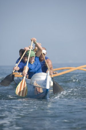 Outrigger canoeing team on water