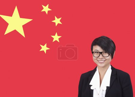 Businesswoman smiling over Chinese flag