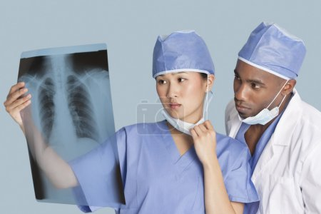 Surgeons examining x-ray report