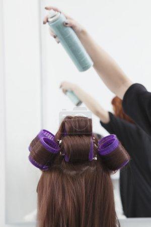 styliste pulvérisations cheveux