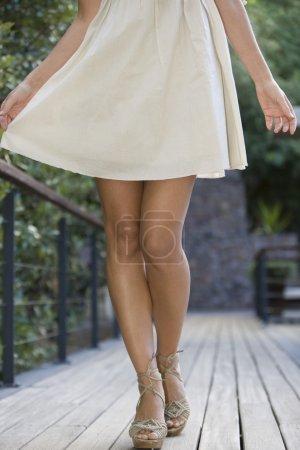 Woman walking is heels