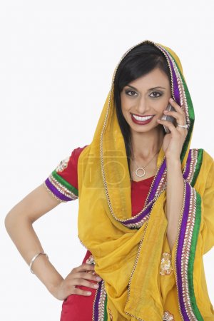 Indian woman answering phone call