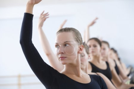 ballet dancers  with arms raised