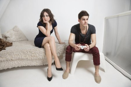 Woman with man playing video game