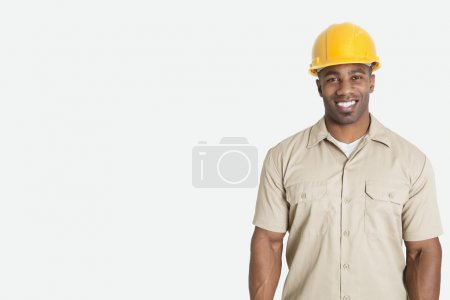 African man wearing yellow hard hat helmet