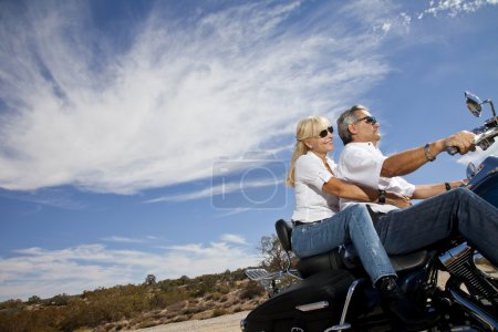 Senior couple riding motorcycle