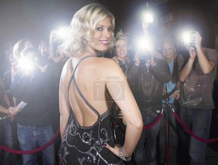 Beautiful woman posing for paparazzi