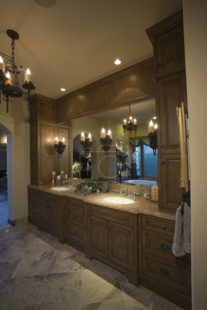 Bathroom with lit chandelier