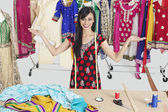 Dressmaker with hand gestures