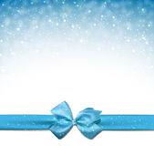Winter blue background with crystallic snowflakes with ribbon and gift bow Christmas decoration Vector