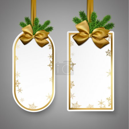 White paper gift cards with golden satin bows.