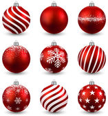 Red christmas balls on white surface Set of isolated realistic decorations Vector illustration