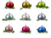 Colorful set of realistic christmas balls on snow with fir branches