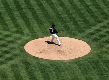 Athletics Brett Anderson steps forward during wind-up to throw p