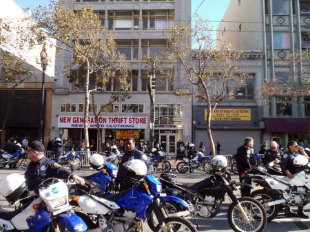 Police officers and motorcycle hang out on a closed market stree