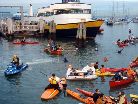 McCovey Cove filled with on rafts and Kayaks in front of