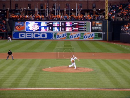 Orioles pitcher Wei-Yin Chen throws ball from mound
