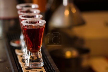 Photo for Barman make alcoholic shots in nightclub - Royalty Free Image
