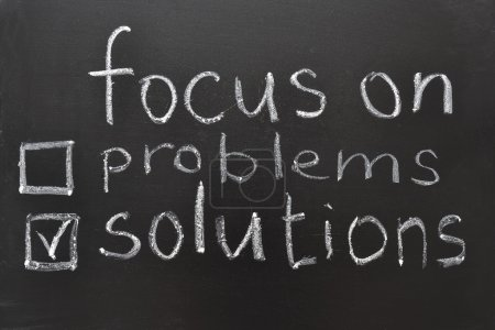Photo for Focus on solutions concept, handwritten on blackboard - Royalty Free Image