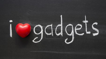 Photo for I Love gadgets phrase handwritten on blackboard - Royalty Free Image