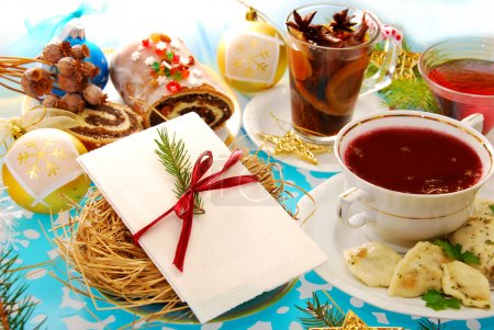 Photo for Polish christmas eve table with white wafer on plate with hay and traditional dishes - Royalty Free Image