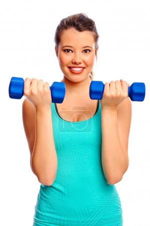 Photo for Young attractive woman trains and tones with weights, isolated on white - Royalty Free Image