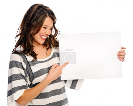 Attractive young woman with blank sign