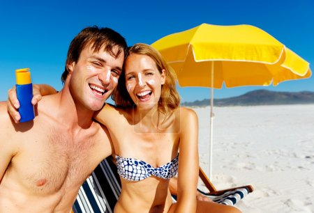 Photo for Suncare couple on a summer beach vacation have good skincare with high spf sunblock - Royalty Free Image