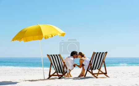 Beach summer umbrella kiss