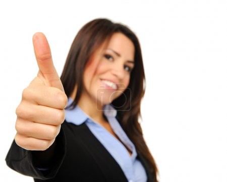 Business woman showing a thumbs up