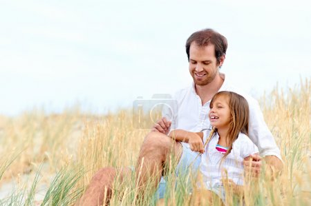 Photo for Adorable father and daughter have fun together happy healthy lifestyle smiles - Royalty Free Image
