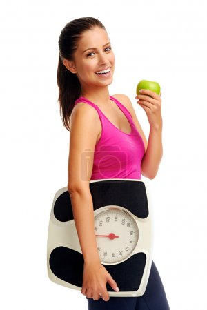 Photo for Healthy diet eating woman with an apple and weightloss - Royalty Free Image
