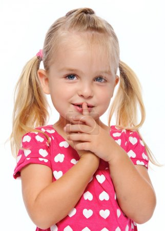 Photo for Young girl with finger on lips gestures to be quiet - Royalty Free Image