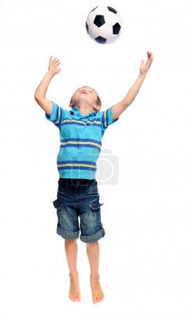 Jumping soccer boy