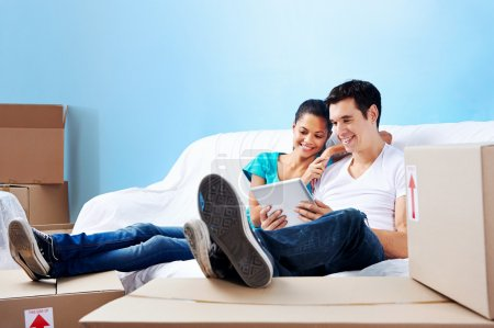 couple on sofa moving