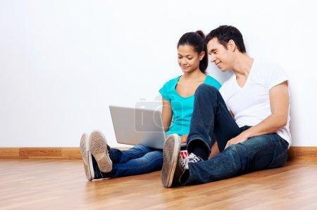 couple laptop floor