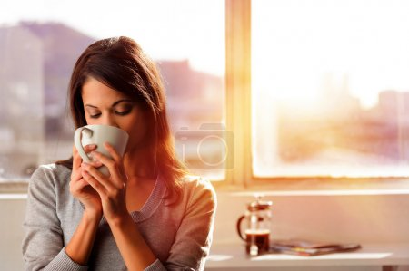 Photo for Woman enjoys fresh coffee in the morning with sunrise at home lifestyle - Royalty Free Image