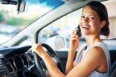Driving businesswoman